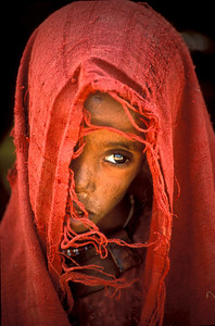 A very sick child in Somalia waiting for medical help.  Photo by Jim Whitmer