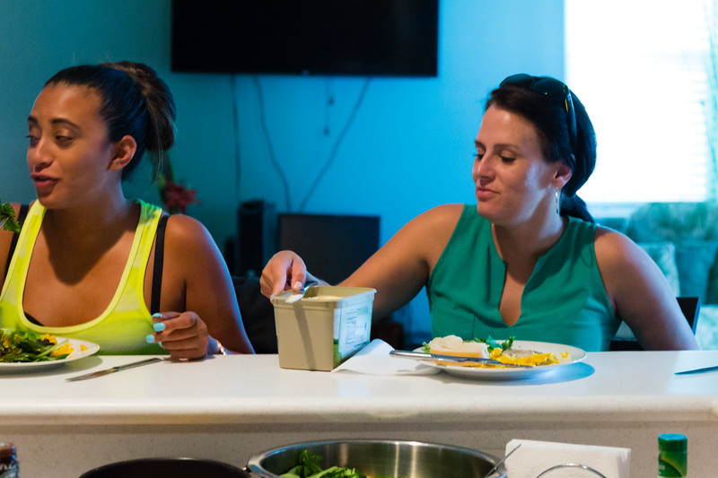 Sober home residents Mariana Lovecchio (left) and Amy Kilgore sit at the kitchen counter and eat dinner that was prepared by resident Shelby Sparrow at the All About Recovery younger women's sober home in Loxahatchee, Florida on Wednesday, June 1, 2016. (Joseph Forzano / The Palm Beach Post)