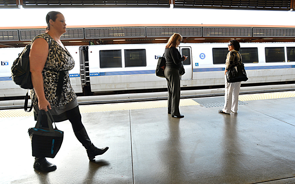 . Lori Myers, of Walnut Creek, walks along the BART platform at the Pleasant Hill BART station on her way to her job in San Francisco, where she will get off at the Embarcadero station, in Pleasant Hill, Calif., on Tuesday, July 20, 2013. Myers, a legal secretary by day and dance instructor by night, is one of many Bay Area commuters without the option to telecommute or take advantage of many ride-sharing options if BART goes out on strike. (Dan Rosenstrauch/Bay Area News Group)
