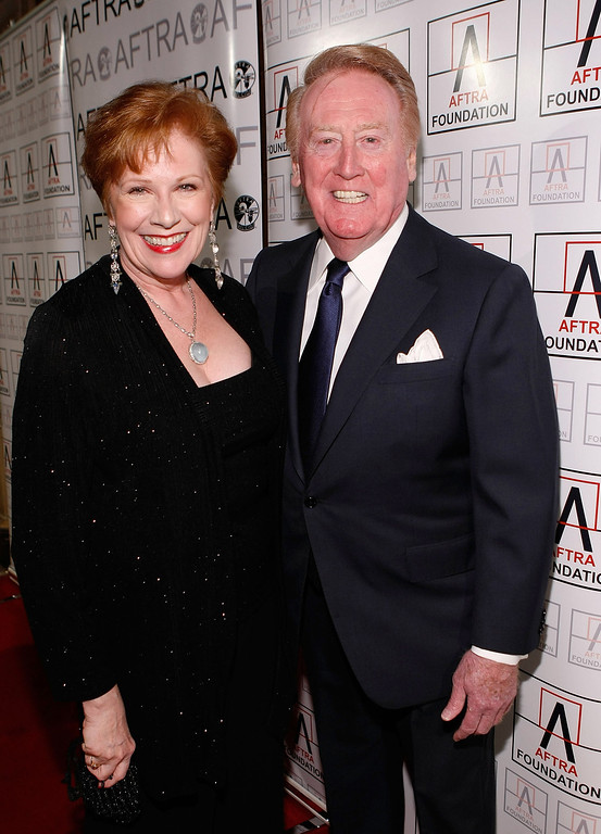 . Roberta Reardon, AFTRA President, and Vin Scully, Los Angeles Dodgers announcer, arrive at the 2009 AFTRA Media and Entertainment Excellence Awards at the Biltmore Hotel on March 9, 2009 in Los Angeles, California.  (Photo by Michael Buckner/Getty Images)