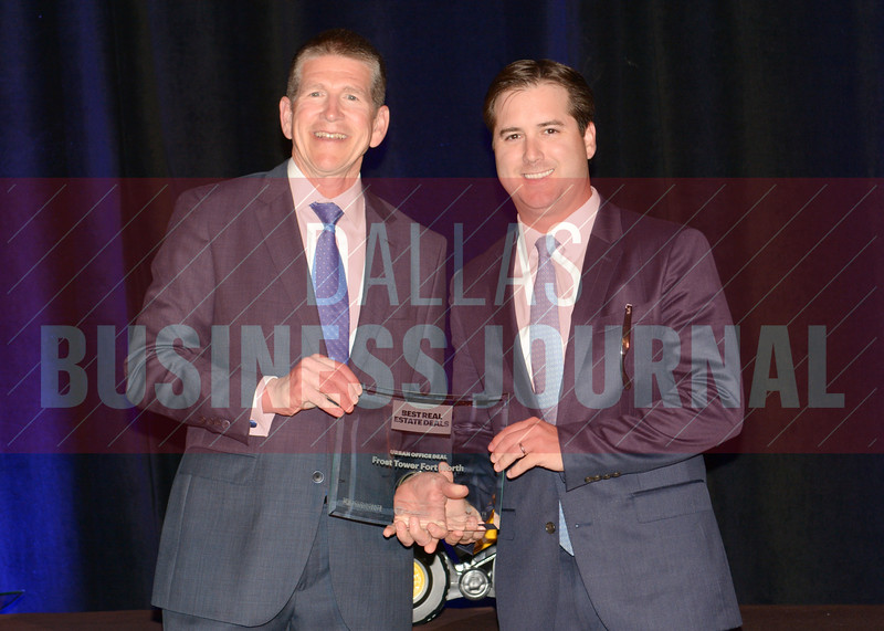 Frost Tower Fort Worth was presented the best Urban Office award from Bret Robertson, left, of presenting sponsor CF Accountants & Consultants.