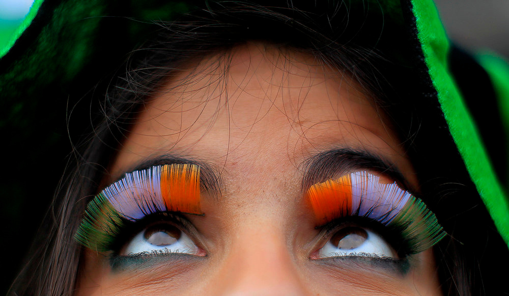 . A woman wears false flag eyelashes during the St. Patrick\'s day parade through Dublin city centre on St. Patrick\'s day, Sunday March 17, 2013. (AP Photo/PA, Julien Behal)
