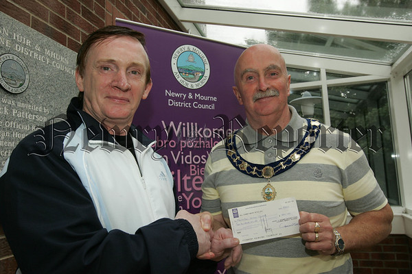 Deputy Mayor Charlie Casey presents a cheque to Gerry Coyle from Newry and Mourne District Council in aid of his upcomoing trek to Everest Base Camp to help raise funds for Macmillan Cancer Support. Picture Peter Clarke. 07W33N35