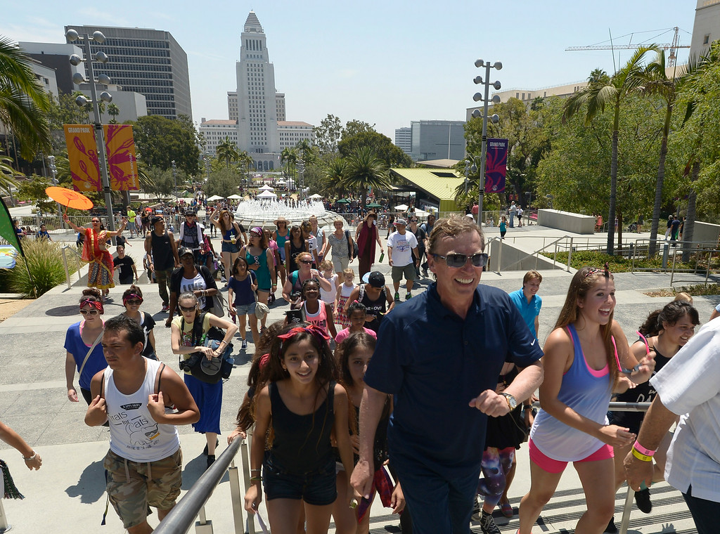 """. Nigel Lythgoe, co-creator and executive producer of \""""So You Think You Can Dance\"""" leads a group of dancers to the Dorothy Chandler Pavilion during the 5th Annual National Dance Day celebration at Grand Park and The Music Center. More than 2,000 people participated in the free all-day dance extravaganza.  Los Angeles CA. 7/25/2014(Photo by John McCoy Daily News)"""