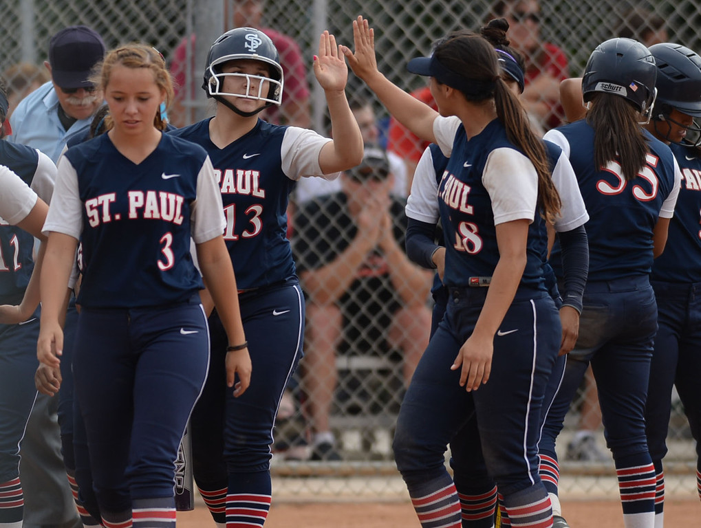 . St. Paul\'s Krystal Gutierrez (13) is high-fived after smacking her second home run (the first was a grand slam) on Palos Verdes in a CIF-SS Division III semifinal softball game Tuesday, May 27, 2014, Palos Verdes Estates, CA.   Gutierrez would add another home run later in the game. Palos Verdes lost 10-0. Photo by Steve McCrank/Daily Breeze