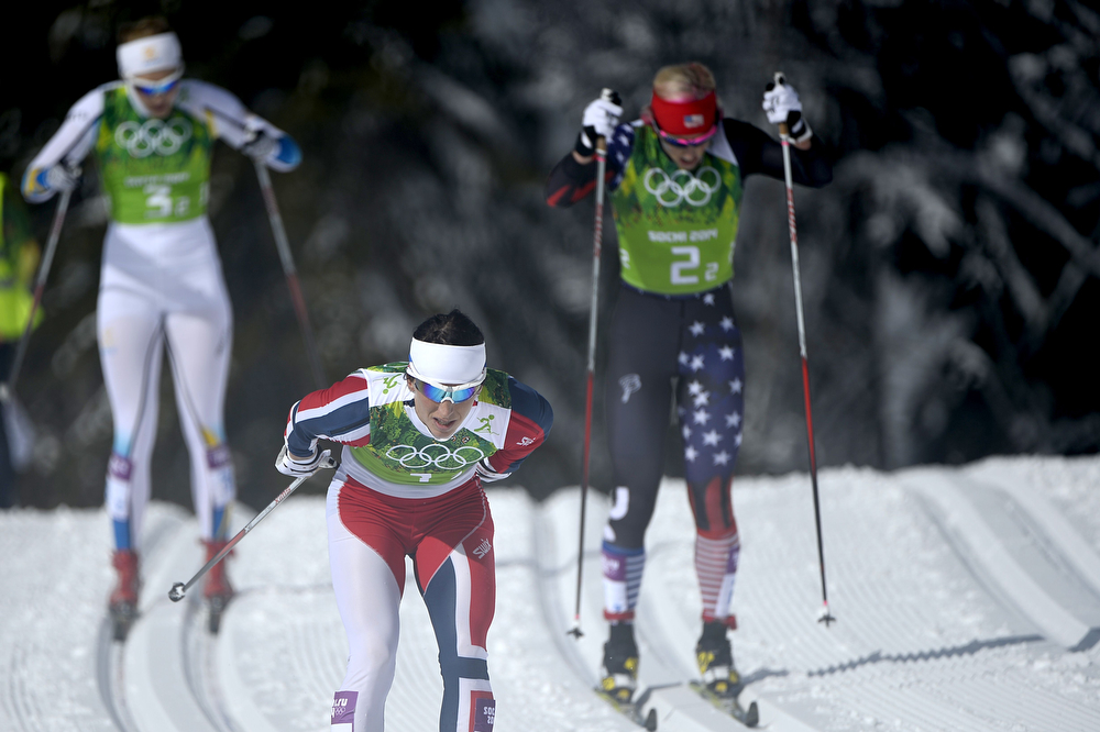 . Sweden\'s Stina Nilsson (L), Norway\'s Marit Bjoergen (front) and US Kikkan Randall (R) compete in the Women\'s Cross-Country Skiing Team Sprint Classic Semifinals at the Laura Cross-Country Ski and Biathlon Center during the Sochi Winter Olympics on February 19, 2014 in Rosa Khutor near Sochi. (PIERRE-PHILIPPE MARCOU/AFP/Getty Images)