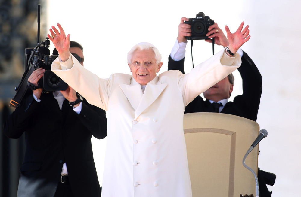 Description of . Pope Benedict XVI waves to the faithful as he arrives in St Peter\'s Square for his final general audience on February 27, 2013 in Vatican City, Vatican. The Pontiff attended his last weekly public audience before stepping down tomorrow. Pope Benedict XVI has been the leader of the Catholic Church for eight years and is the first Pope to retire since 1415. He cites ailing health as his reason for retirement and will spend the rest of his life in solitude away from public engagements.  (Photo by Franco Origlia/Getty Images)