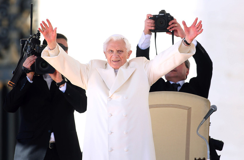 . Pope Benedict XVI waves to the faithful as he arrives in St Peter\'s Square for his final general audience on February 27, 2013 in Vatican City, Vatican. The Pontiff attended his last weekly public audience before stepping down tomorrow. Pope Benedict XVI has been the leader of the Catholic Church for eight years and is the first Pope to retire since 1415. He cites ailing health as his reason for retirement and will spend the rest of his life in solitude away from public engagements.  (Photo by Franco Origlia/Getty Images)