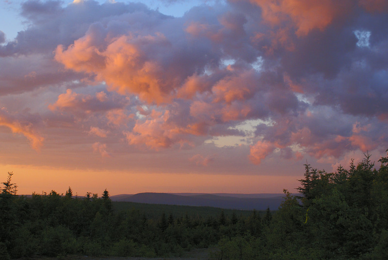 Sunset at Mount Mitchell. It you look carefully you may be able to pick out one of approximately 20 wind turbines on the horizon, closer to the town of Bathurst to the north.  Photo taken 21 June 2010.