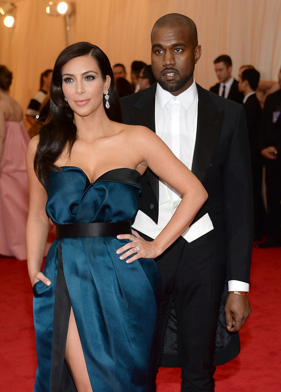 """. Kim Kardashian, left, and Kanye West attend The Metropolitan Museum of Art\'s Costume Institute benefit gala celebrating \""""Charles James: Beyond Fashion\"""" on Monday, May 5, 2014, in New York. (Photo by Evan Agostini/Invision/AP)"""