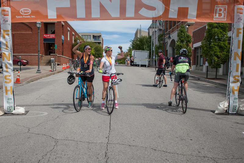 Ambitious cyclists of all ages took off on the Razorback Greenway riding the 30 miles from Bentonville Square to Fayetteville Square.  Throughout the trail pit stops could be found where local business and bands provided water, food, and entertainment.  The leisurely ride began in the rain with waves begining at 8 a.m. and the last one leaving Bentonville with sunny skies at 10:30 a.m.