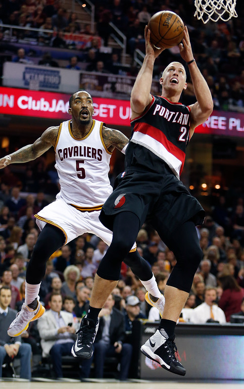 . Portland Trail Blazers\' Mason Plumlee (24) shoots against Cleveland Cavaliers\' J.R. Smith (5) during the second half of an NBA basketball game Wednesday, Nov. 23, 2016, in Cleveland. The Cavaliers won 137-125. (AP Photo/Ron Schwane)