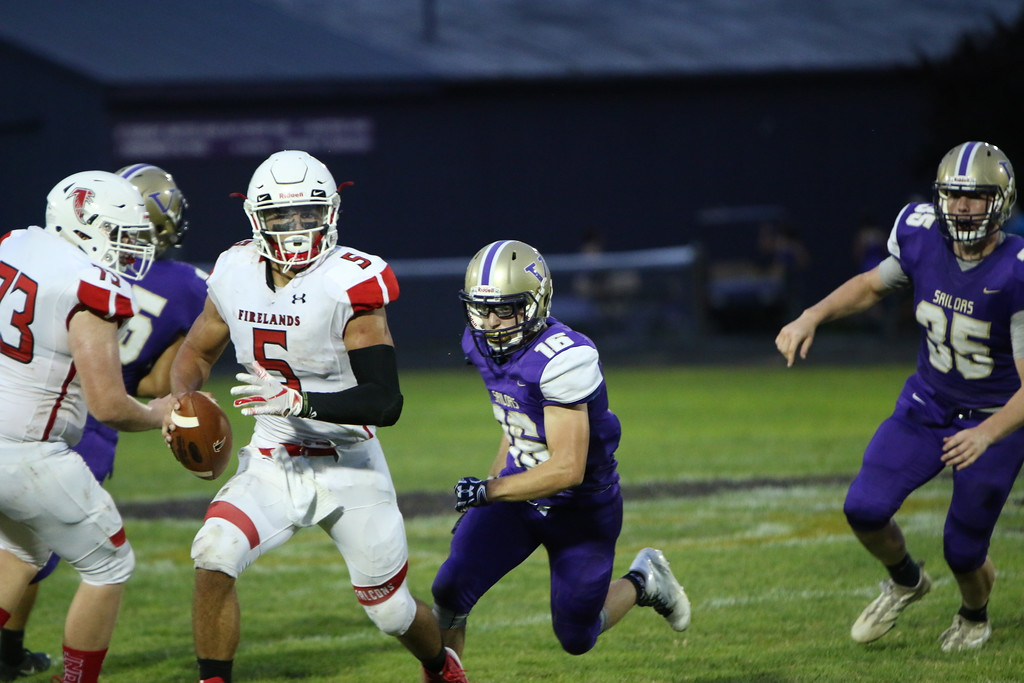 . Kyle Sooy - The Morning Journal<br> Firelands\' Blake Ruffner scrambles agiainst Vermilon on Sept. 7.
