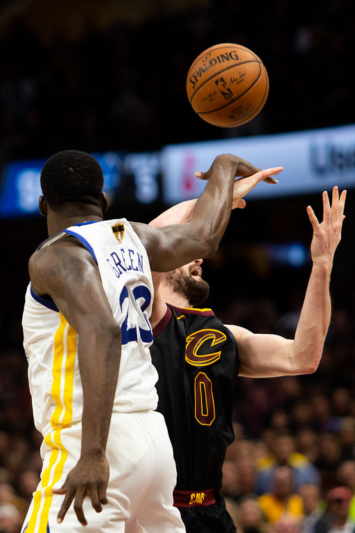 . Draymond Green (23) and Kevin Love (0) collide during game 3 of the NBA Finals in Cleveland on June 6, 2018.  Michael Johnson/ The News Herald