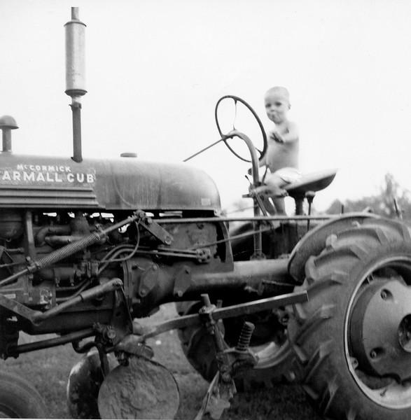 Alan on the neighbor's tractor.