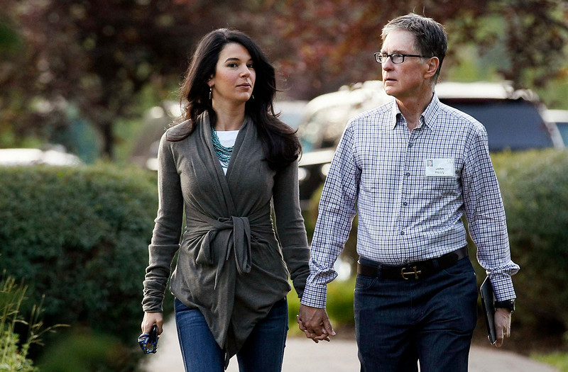 . Boston Red Sox owner John Henry (R) with wife Linda Pizzuti arrives for the first session of annual Allen and Co. conference at the Sun Valley, Idaho Resort July 10, 2013.  REUTERS/Rick Wilking
