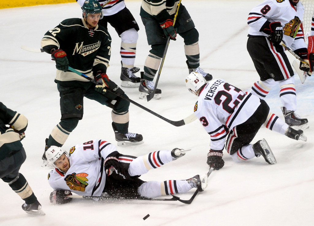 . Chicago Blackhawks center Marcus Kruger falls to stop a puck during the third period. (Pioneer Press: Sherri LaRose-Chiglo)