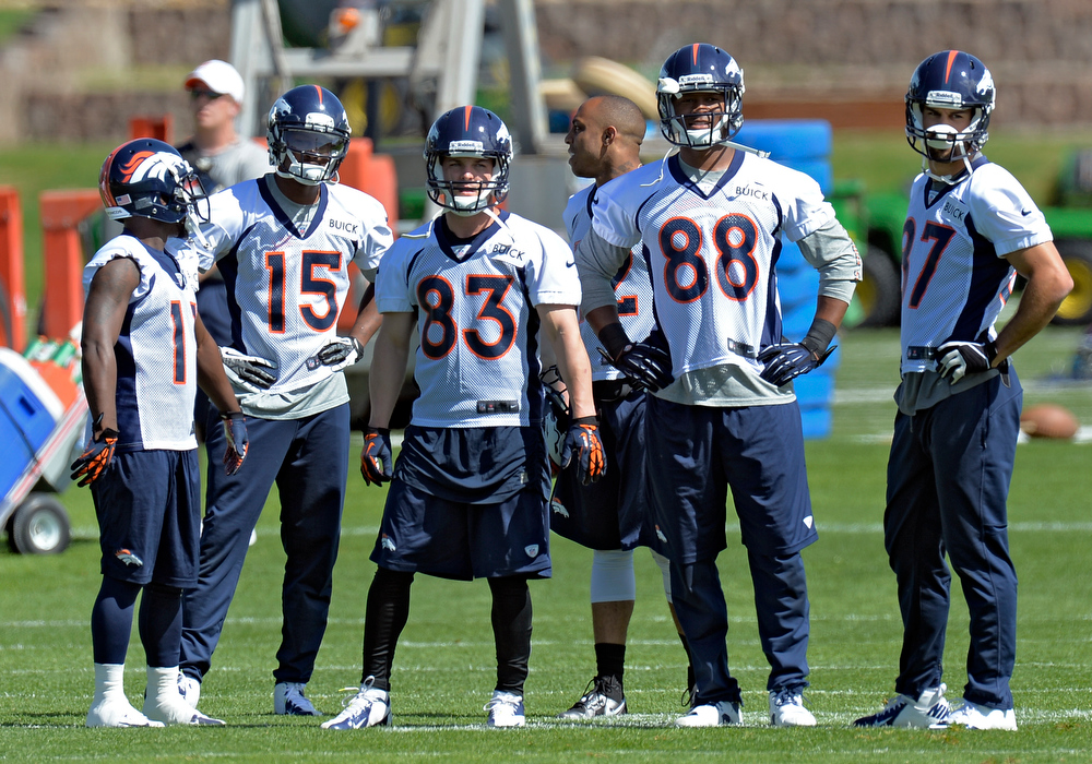 . Denver Broncos wide receivers Trindon Holliday (11) Tavarres King (15) Wes Welker (83) Andre Caldwell (12) Demaryius Thomas (88) and Erick Decker (87) look on during the teams OTAs May 20, 2013 at Dove Valley. All offseason training activities (OTAs) are voluntary until the mandatory minicamp June 11-13. (Photo By John Leyba/The Denver Post)