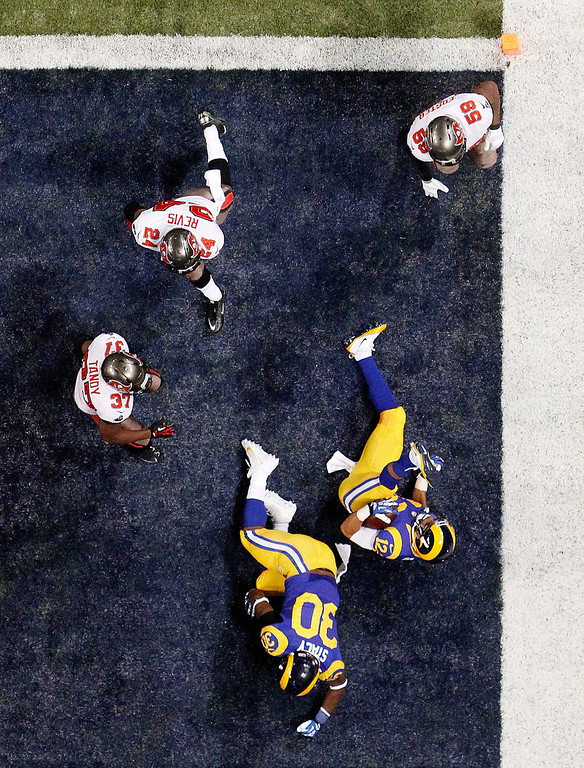 . St. Louis Rams wide receiver Stedman Bailey (12) tumbles in the end zone as he scores on a 27-yard reverse during the second quarter of an NFL football game against the Tampa Bay Buccaneers on Sunday, Dec. 22, 2013, in St. Louis. The Rams won 23-13. (AP Photo/St. Louis Post-Dispatch, Chris Lee)
