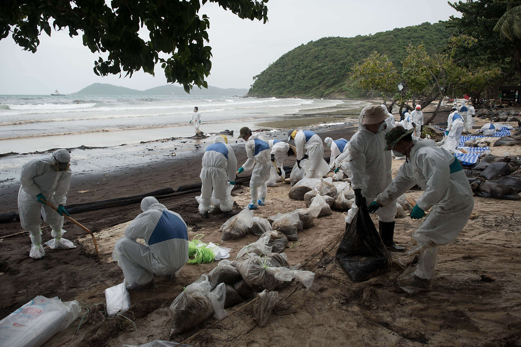 . Royal Thai Navy personnel work to clean up from a major oil slick on Ao Phrao beach on the island of Ko Samet on July 30, 2013. Thai navy personnel battled to clean up the major oil slick which coated a beach on the popular tourist island in a national park after a pipeline leak.   NICOLAS ASFOURI/AFP/Getty Images