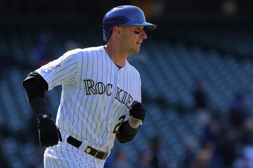 . Troy Tulowitzki #2 of the Colorado Rockies rounds the bases on his solo homerun off of Jeremy Hefner #53 of the New York Mets in the eighth inning at Coors Field on April 18, 2013 in Denver, Colorado.  (Photo by Doug Pensinger/Getty Images)