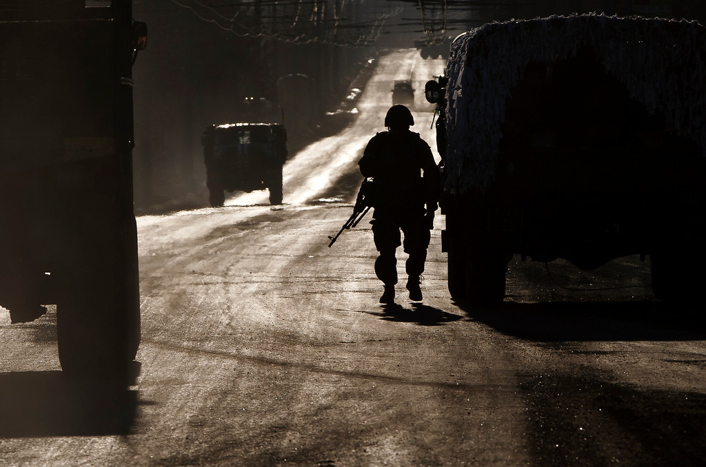 . An Ukrainian soldier stands next to a broken down vehicle outside Artemivsk, Ukraine, as troops pull out of Debaltseve, Wednesday, Feb. 18, 2015. After weeks of relentless fighting, the embattled Ukrainian rail hub of Debaltseve fell Wednesday to Russia-backed separatists, who hoisted a flag in triumph over the town. The Ukrainian president confirmed that he had ordered troops to pull out and the rebels reported taking hundreds of soldiers captive.(AP Photo/Vadim Ghirda)