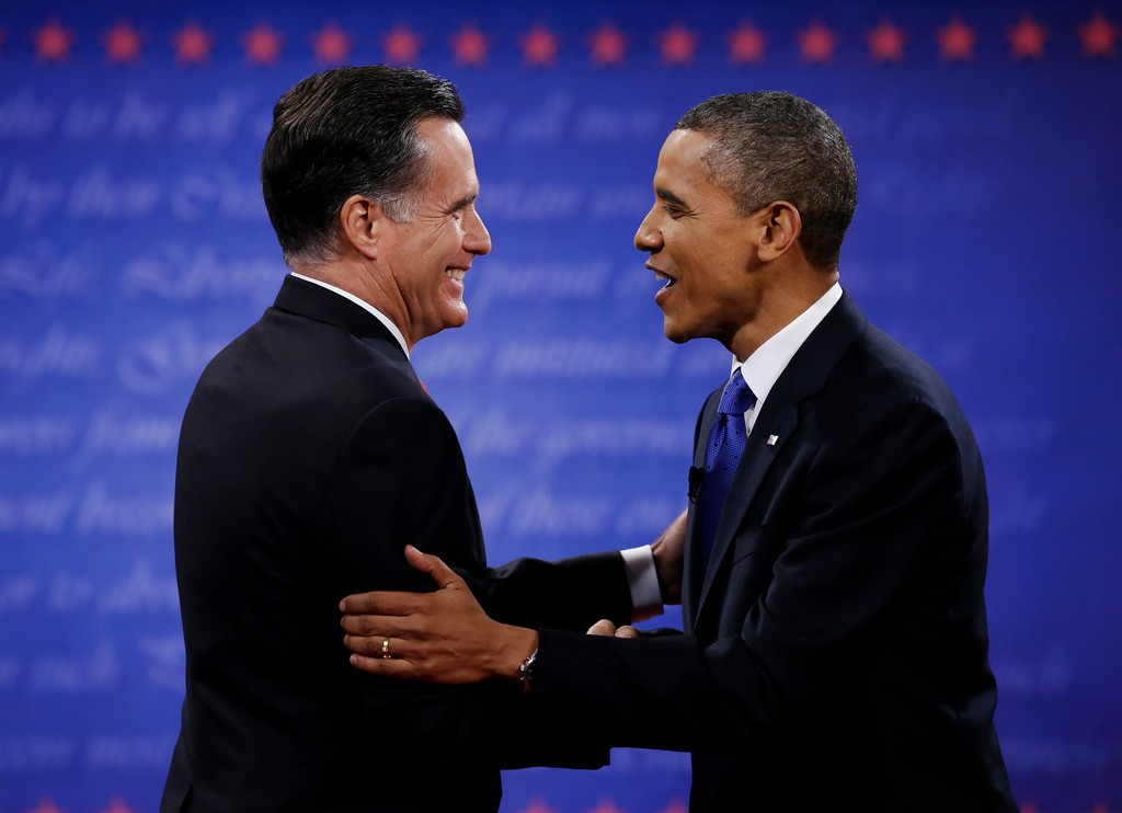 . President Barack Obama, right, and Republican presidential nominee Mitt Romney shake hands following their third presidential debate at Lynn University, Monday, Oct. 22, 2012, in Boca Raton, Fla. (AP Photo/David Goldman)