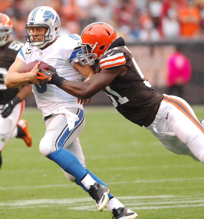 . Michael Allen Blair/MBlair@21st-CenturyMedia.com Browns\' linebacker Barkevious Mingo can\'t bring down the Lions\' Matthew Stafford as he slips away for a gain during the second quarter versus the Lions at FirstEnergy Stadium in Cleveland, OH. on Sunday, October 13, 2013.