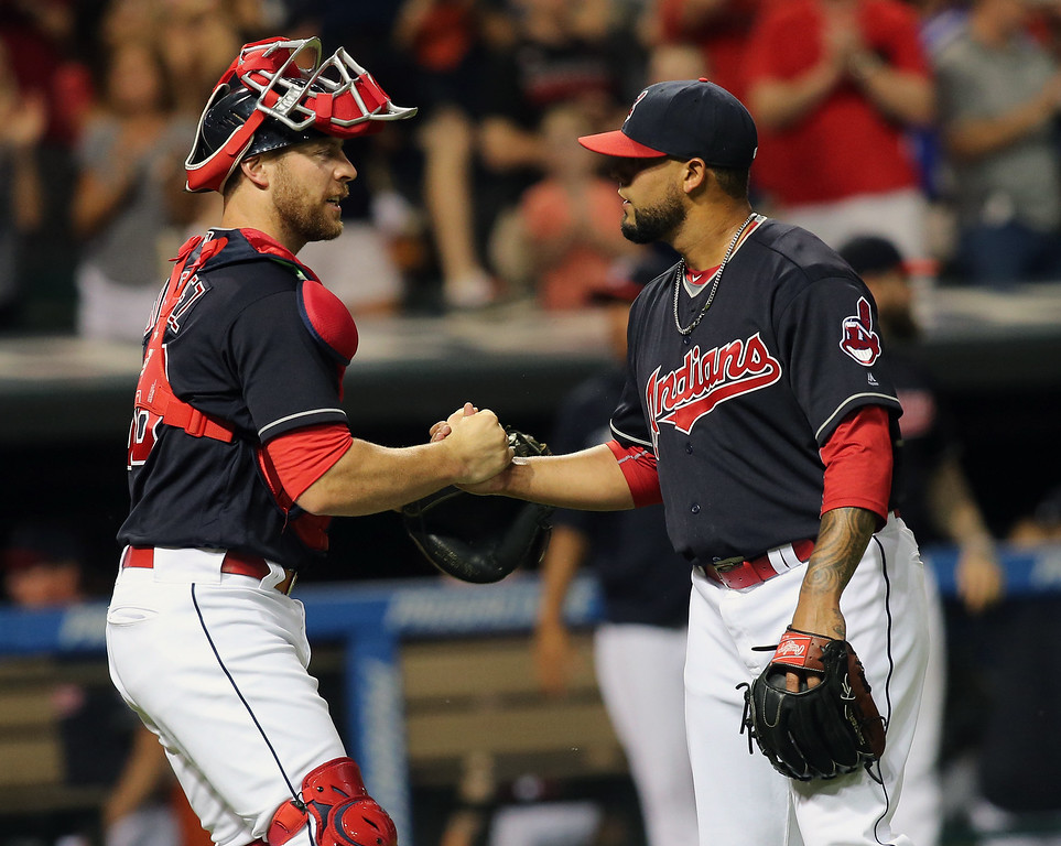 . Cleveland Indians\' relief pitcher Joseph Colon, right, shakes hands with catcher Yan Gomes after closing out a 10-2 win in a baseball game against the New York Yankees, Friday, July 8, 2016, in Cleveland. (AP Photo/Aaron Josefczyk)