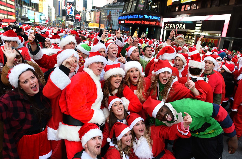 . People dressed as Santa Claus and Mrs. Claus pose in Times Square as they gather for the annual Santacon festivities on December 13, 2014 in New York. AFP PHOTO/DON EMMERT/AFP/Getty Images