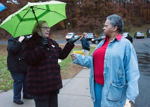 11/06/18 Wesley Bunnell | Staff State Senator Terry Gerratana speaks to Pastor Pauline Wilkins of Another Chance Church as she heads into the polling location at Pulaski Middle School on Tuesday afternoon.