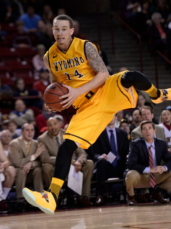 . Wyoming Cowboys guard Josh Adams (14) save the ball from join gout of bounds during the first half December 15, 2013 Magness Arena. (Photo by John Leyba/The Denver Post)
