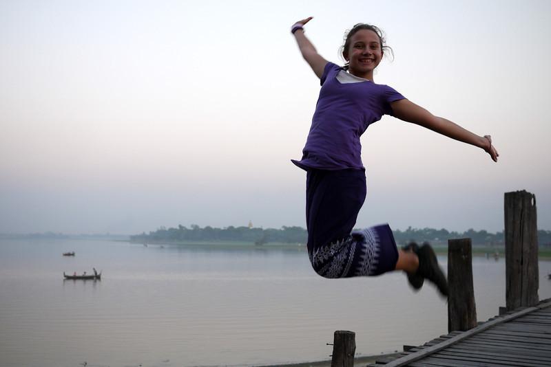 Ana executes a jumping shot from U Bein Bridge near Mandalay.