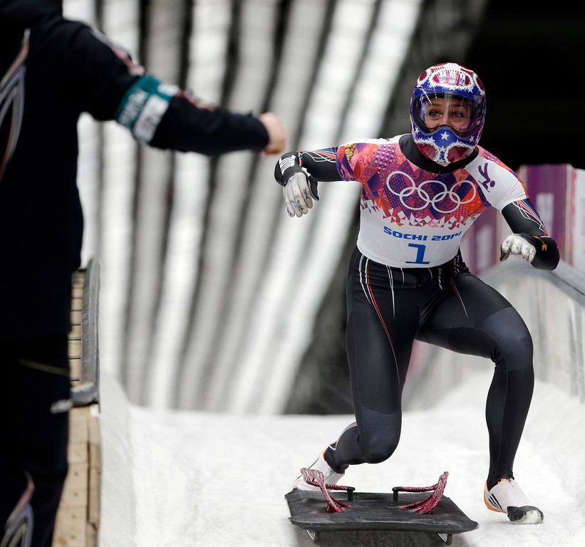 . Noelle Pikus-Pace of the United States celebrates her silver medal win in the finish area after the women\'s skeleton competition at the 2014 Winter Olympics, Friday, Feb. 14, 2014, in Krasnaya Polyana, Russia. (AP Photo/Dita Alangkara)