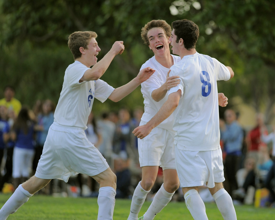 . 02-15-2012--(LANG Staff Photo by Sean Hiller)- Los Alamitos beat Buena 4-1 in the first round of the Division 1 boys soccer playoffs Friday at Laurel School in Los Alamitos. Sam Rudich (8) celebrates his second half goal with Brett Hall (20),center, and Aron Rudich (6), left,.