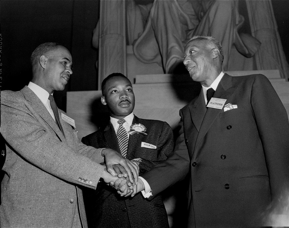 . Pictured left to right at the Freedom Pilgrimage rally at the Lincoln Memorial, Washington, D.C., May 17, 1957, are:  Roy Wilkins of New York, executive secretary of the NAACP; the Rev. Martin Luther King, Jr. of Montgomery, Ala.; and A. Philip Randolph of New York, president of the Brotherhood of Sleeping Car Porters.  (AP Photo/Charles Gorry)
