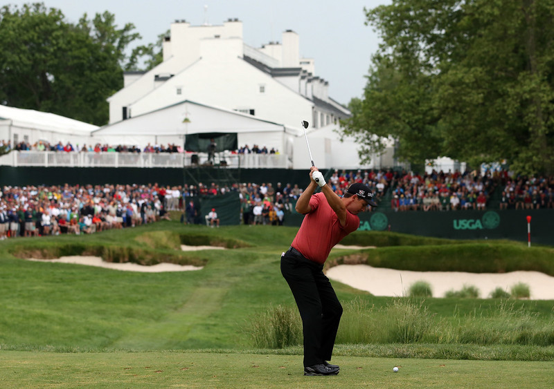 . Padraig Harrington of Ireland hits his tee shot on the 13th hole during Round One of the 113th U.S. Open at Merion Golf Club on June 13, 2013 in Ardmore, Pennsylvania.  (Photo by Andrew Redington/Getty Images)