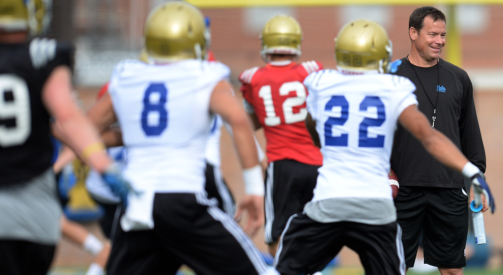 . UCLA head coach Jim Mora during football practice at Spaulding Field on the UCLA campus Thursday, April 17, 2014. (Photo by Hans Gutknecht/Los Angeles Daily News)