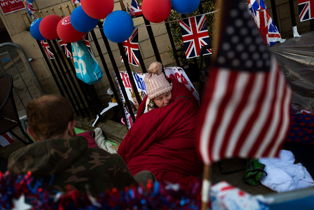 . A woman spends the night near Windsor castle, England, Friday, May 18, 2018. Preparations continue in Windsor ahead of the royal wedding of Britain\'s Prince Harry and Meghan Markle Saturday May 19. (AP Photo/Emilio Morenatti)