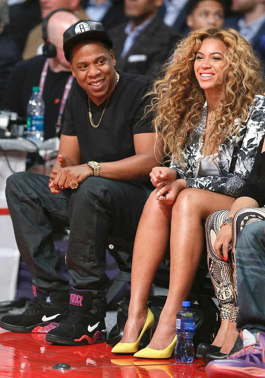 . Singer Beyonce and her husband Jay-Z sit courtside before the NBA All-Star basketball game in Houston, Texas, February 17, 2013.  REUTERS/Lucy Nicholson