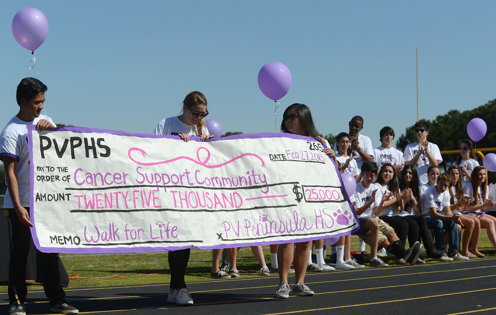 . Hundreds of Peninsula High School students took part in the school\'s Walk for Life on Wednesday which raises money for cancer research and awareness.  The school raised $25,000 for City of Hope and another $25,000 for Cancer Support Community. 20130227 Photo by Steve McCrank / Staff Photographer