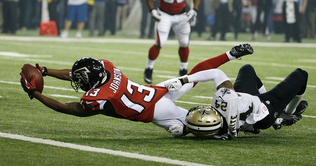 . Atlanta Falcons wide receiver Darius Johnson (13) heads to the end zone against New Orleans Saints cornerback Corey White (24) during the first half of an NFL football game, Thursday, Nov. 21, 2013, in Atlanta. The play was ruled not a touchdown after review.  (AP Photo/David Goldman)