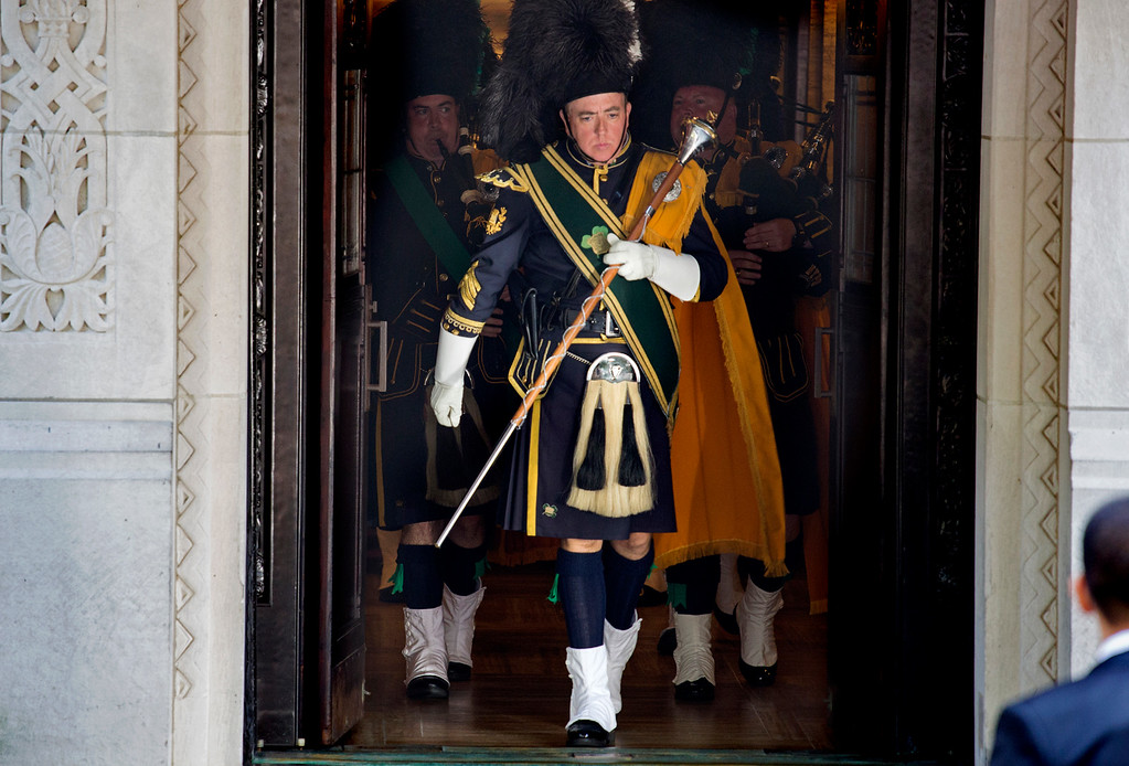 . Bagpipers march out the doors of Temple Emanu-El after the funeral service for comedian Joan Rivers in New York Sunday, Sept. 7, 2014. Rivers died Thursday at 81. (AP Photo/Craig Ruttle)