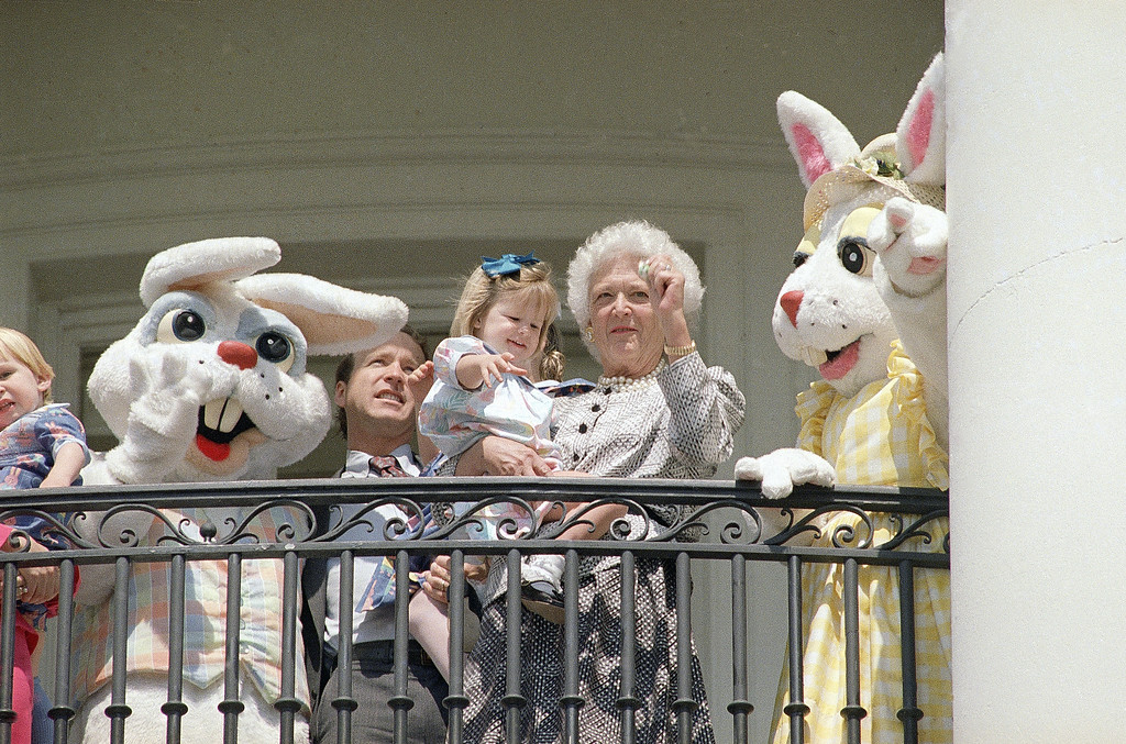 . First lady Barbara Bush, granddaughter Marshall Bush, and son Neil Bush are flanked by Easter bunnies as they stand on the White House balcony in Washington, March 27, 1989. (AP Photo/Bob Daugherty)