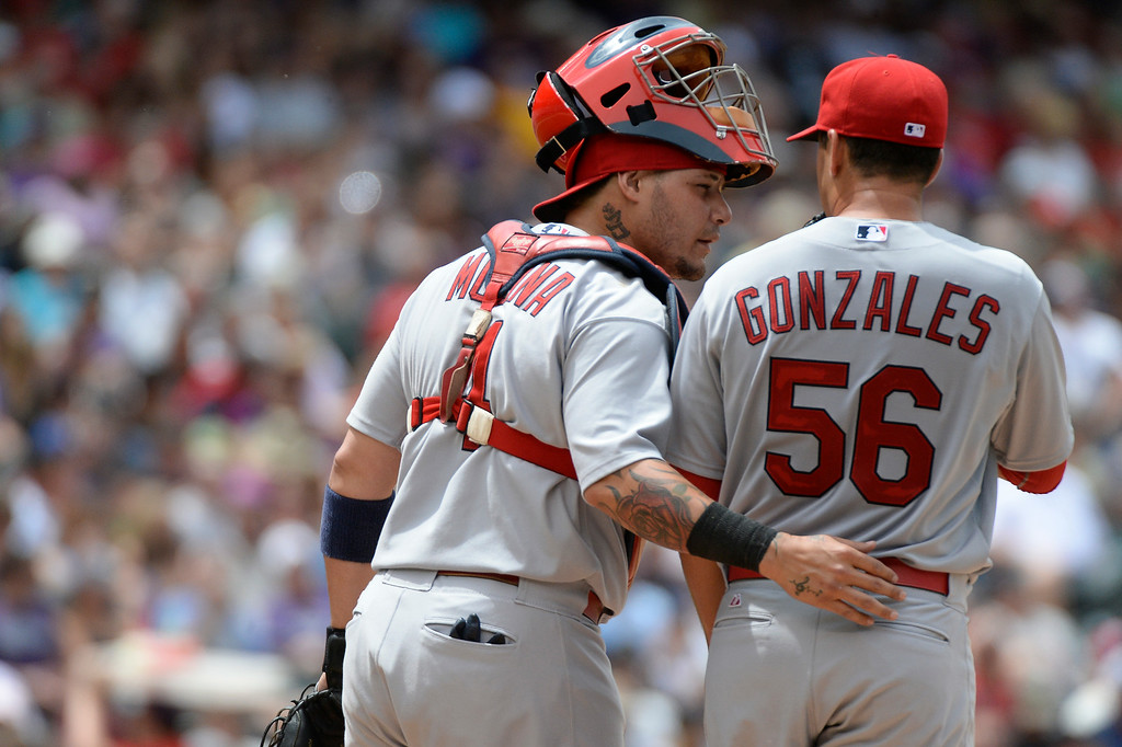 . St. Louis Cardinals catcher Yadier Molina (4) talks with St. Louis Cardinals starting pitcher Marco Gonzales (56) on the mound during the fourth inning against the Colorado Rockies June 25, 2014 at Coors Field. (Photo by John Leyba/The Denver Post)
