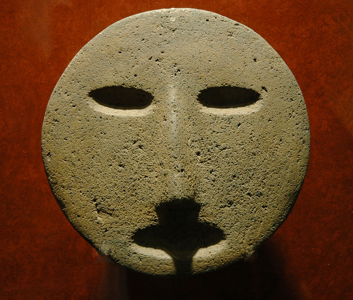 carved stone face in anthropological Museum in Mexico City