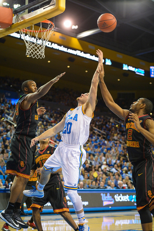. UCLA�s Bryce Alford and USC�s Roschon Prince and D.J. Haley go after a rebound during game action at Pauley Pavilion Sunday, December 5, 2014. UCLA  defeated USC 107-73.  Photo by David Crane/Los Angeles Daily News.