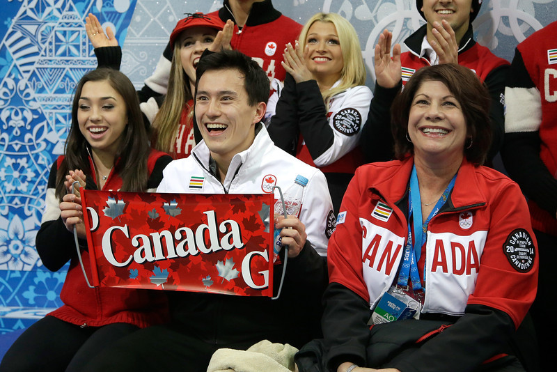 . Patrick Chan of Canada looks on with teammates while waiting for his scores after competing in the Figure Skating Men\'s Short Program during the Sochi 2014 Winter Olympics at Iceberg Skating Palace on February 6, 2014 in Sochi, Russia.  (Photo by Darren Cummings/Pool/Getty Images)