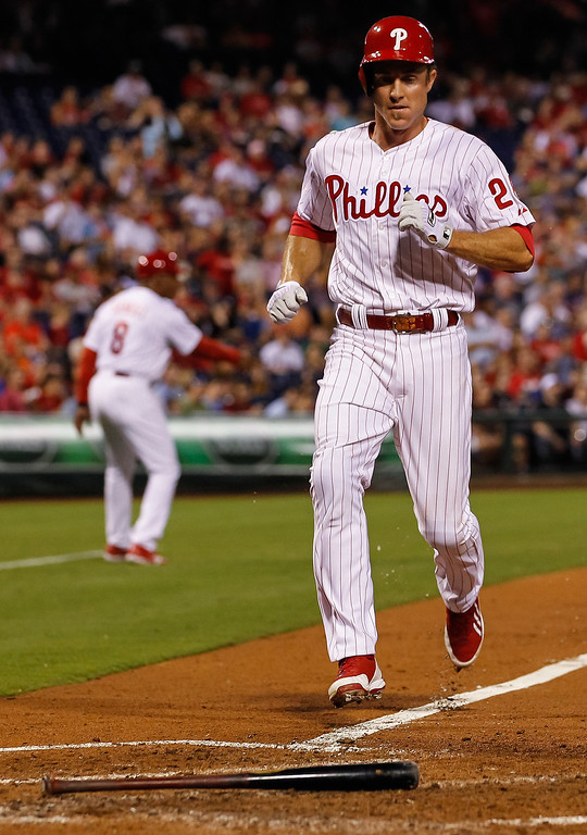 . Chase Utley #26 of the Philadelphia Phillies scores a run in the fourth inning of the game against the Colorado Rockies  at Citizens Bank Park on August 19, 2013 in Philadelphia, Pennsylvania. (Photo by Brian Garfinkel/Getty Images)