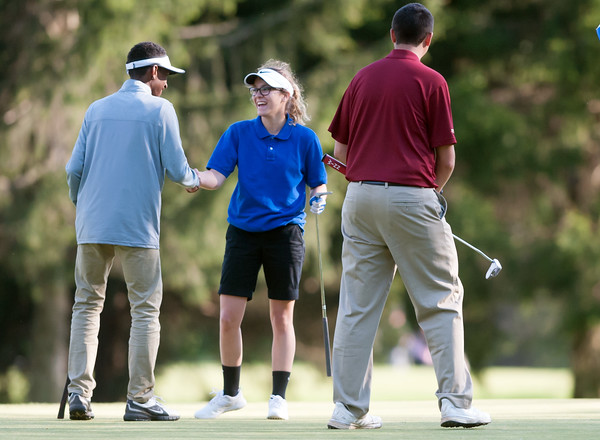 05/10/18 Wesley Bunnell   Staff New Britain golf defeated Bristol Eastern 212-219 at Stanley Golf Course on Thursday afternoon. New Britain's Dylan Washington, L, shakes hands with Bristol Eastern's Olivia Beaudoin at the conclusion of the match.
